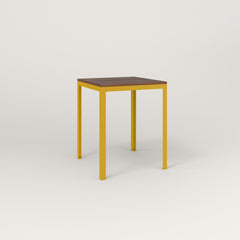 RAD Signature Square Cafe Table, in slatted wood and yellow powder coat.