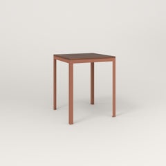 RAD Signature Square Cafe Table, in slatted wood and coral powder coat.