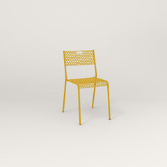 RAD Signature Dining Chair in perforated steel and yellow powder coat.