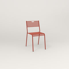 RAD Signature Dining Chair in perforated steel and red powder coat.