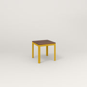 RAD Signature Simple Stool in slatted wood and yellow powder coat.