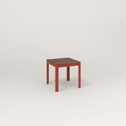 RAD Signature Simple Stool in slatted wood and red powder coat.