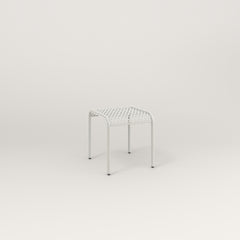 RAD Signature Bent Tube Stool in perforated steel and white powder coat at dining height.