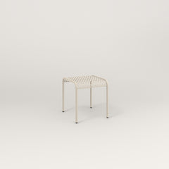 RAD Signature Bent Tube Stool in perforated steel and off-white powder coat at dining height.