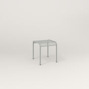 RAD Signature Bent Tube Stool in perforated steel and grey powder coat at dining height.