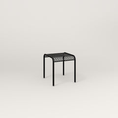 RAD Signature Bent Tube Stool in perforated steel and black powder coat at dining height.