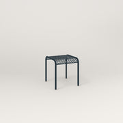 RAD Signature Bent Tube Stool in perforated steel and navy powder coat at dining height.