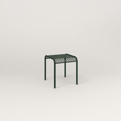 RAD Signature Bent Tube Stool in perforated steel and fir green powder coat at dining height.