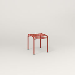 RAD Signature Bent Tube Stool in perforated steel and red powder coat at dining height.