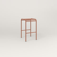 RAD Signature Bent Tube Stool in perforated steel and coral powder coat.