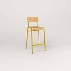 RAD School Bar Stool in bent plywood and yellow powder coat.