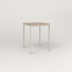 RAD Solid Square Cafe Table, in tricoya and white powder coat.