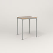 RAD Solid Square Cafe Table, in tricoya and grey powder coat.