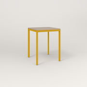 RAD Solid Square Cafe Table, in tricoya and yellow powder coat.