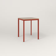 RAD Solid Square Cafe Table, in tricoya and red powder coat.