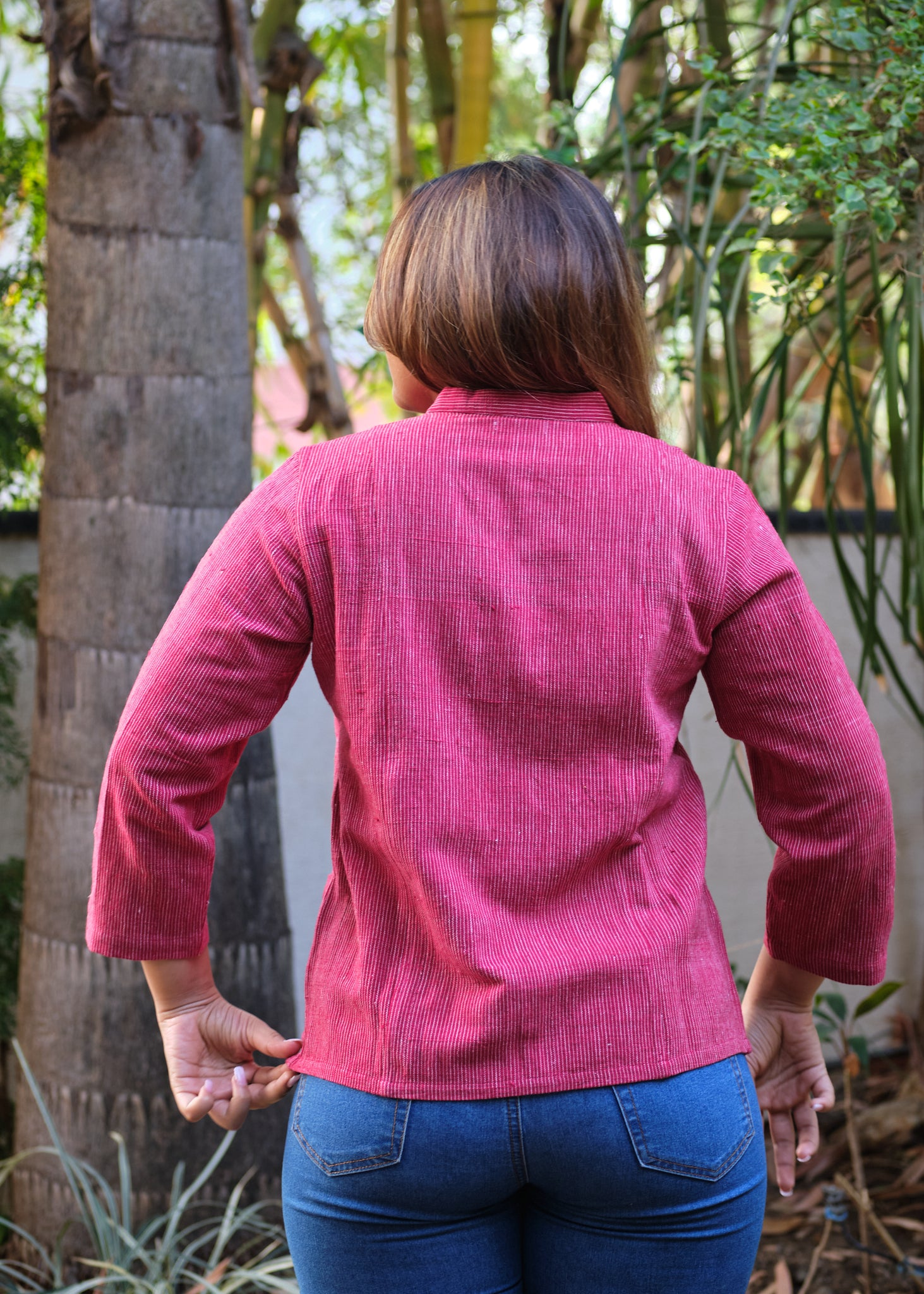 woman in a red shirt back side view