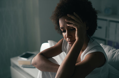 Woman with a headache. cbd for depression for sale. does cbd oil help with depression? How to use cbd for depression. How much cbd should i take for depression?