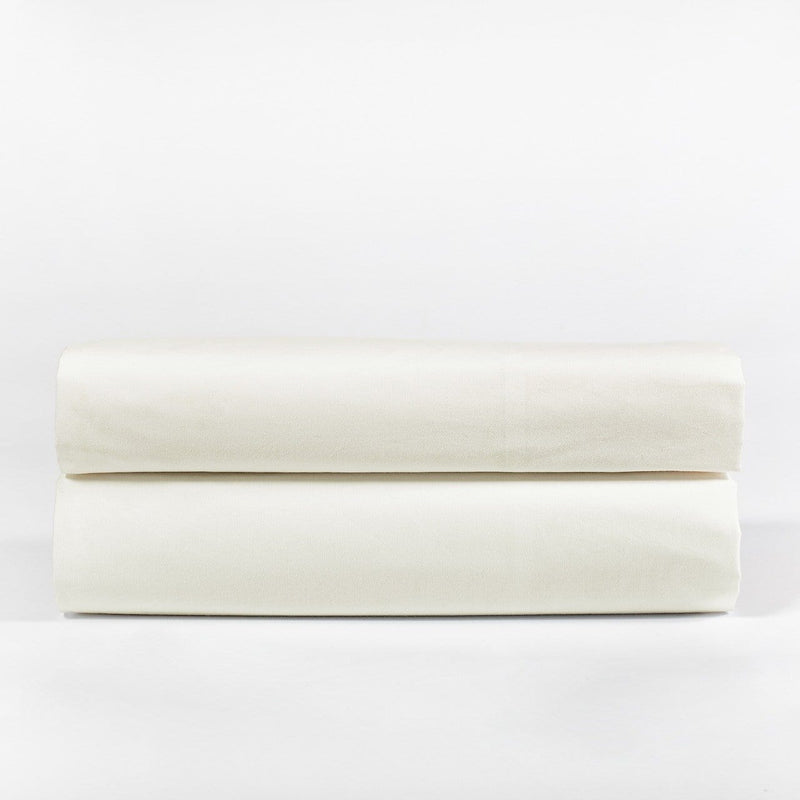 Folded Ivory Bedding Set with white background