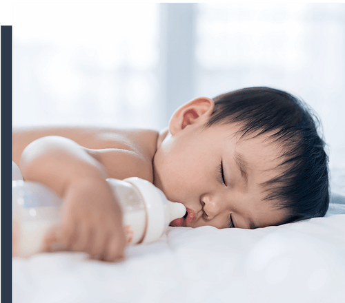Cute Baby Sleeping on Bed Sheets
