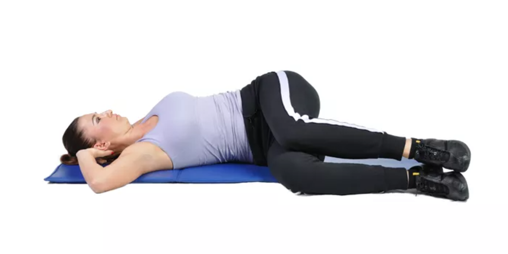 supine twist exercice étirement dos
