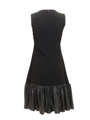 Back view of sleeveless jumper with metallic ruffle bottom