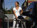 Woman adding Green Fuel Tabs and filling her tank