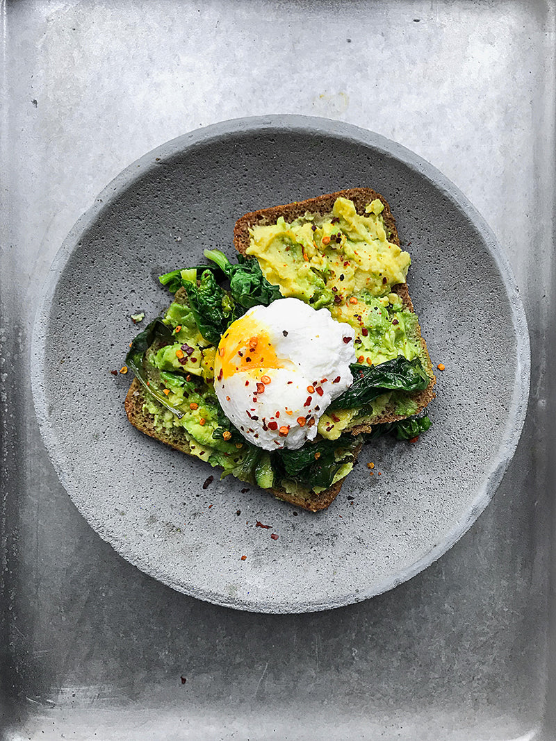 Avocado and eggs on toast for protein as part of a diet to help hair grow faster