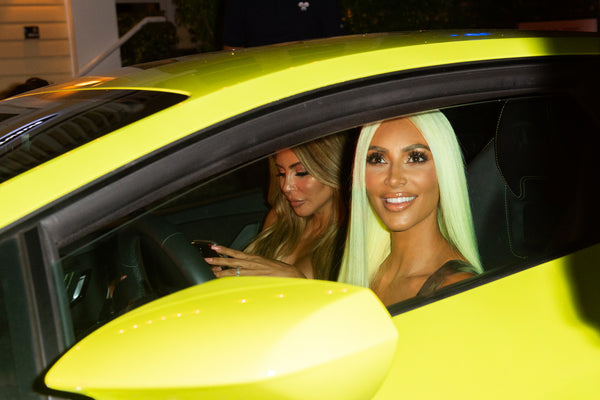 Kim Kardashian in a car with neon green hair
