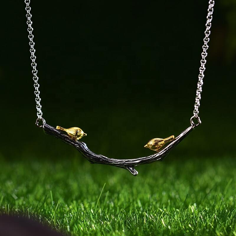 Gold Bird on Silver Branch Necklace Pendant