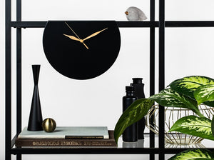 round black clock with gold hands
