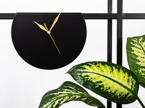 melting  round black clock
