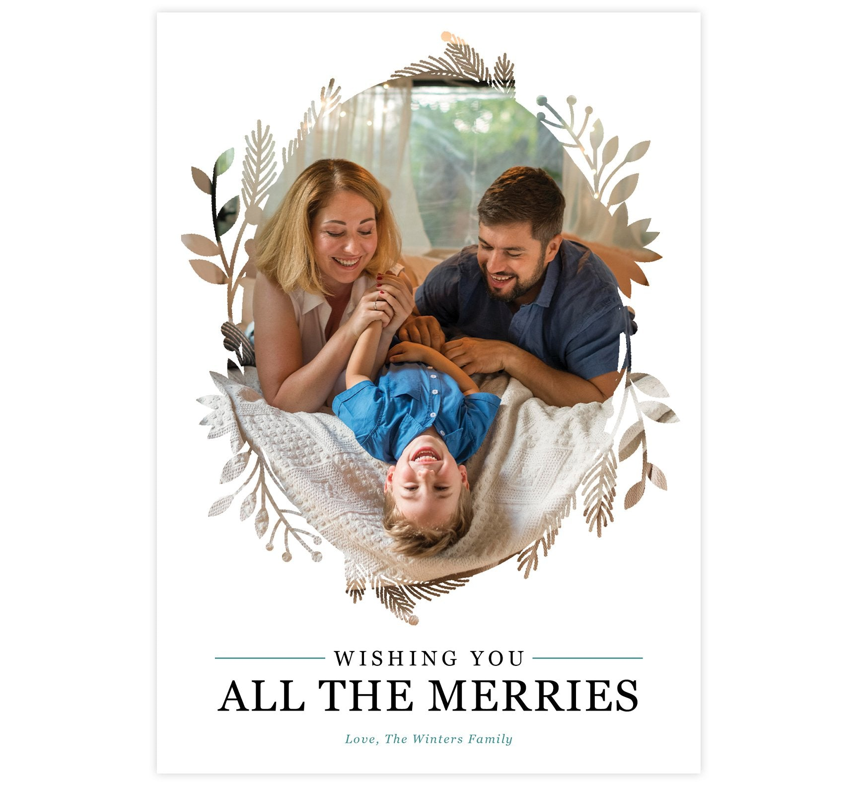 "All the Merries Holiday Card; White background with large image in the middle and wreath design around the edges of the photo. Black text that says ""Wishing you all the merries"" and teal text with the signature."
