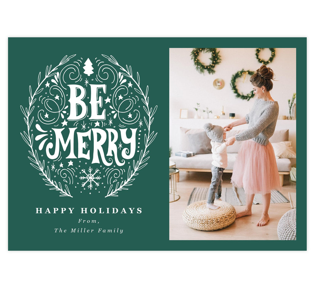 "Be Merry Holiday Card; Teal/Green background with drawn ""Be Merry"" design in white. 'Happy holidays' written under the be merry design and spot for photo on the right."