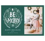 "Load image into Gallery viewer, Be Merry Holiday Card; Teal/Green background with drawn ""Be Merry"" design in white. 'Happy holidays' written under the be merry design and spot for photo on the right."