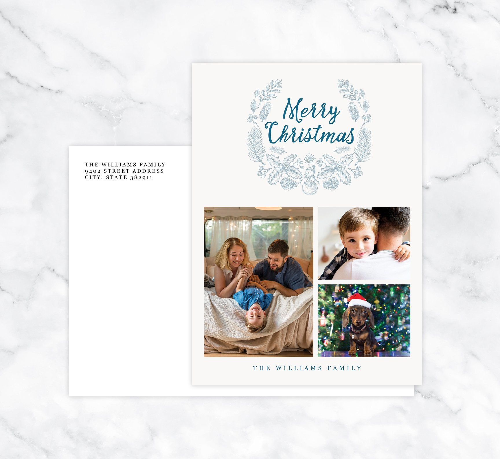 Blue Wreath Holiday Card Mockup; Holiday card with envelope and return address printed on it.