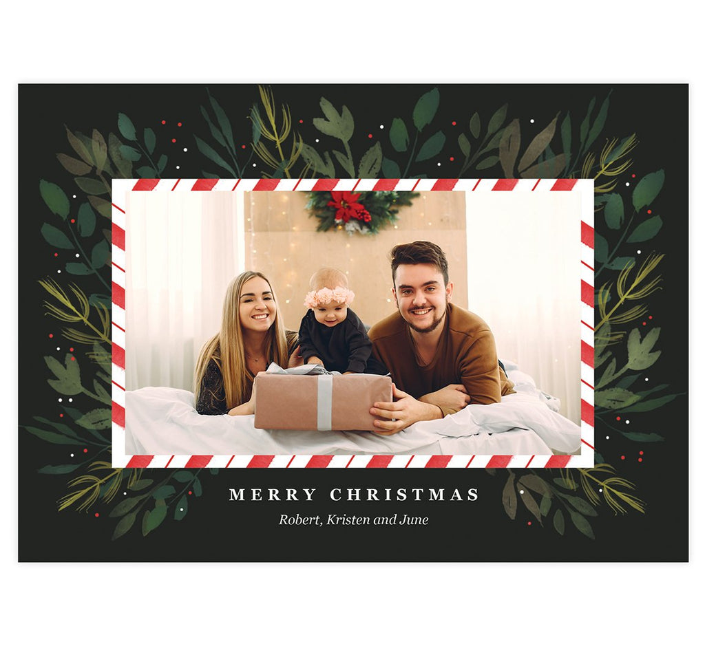 Candy Cane Frame Holiday Card; Dark backgrond, one image spot with a candy cane design frame around the image and watercolor greenery around the frame.