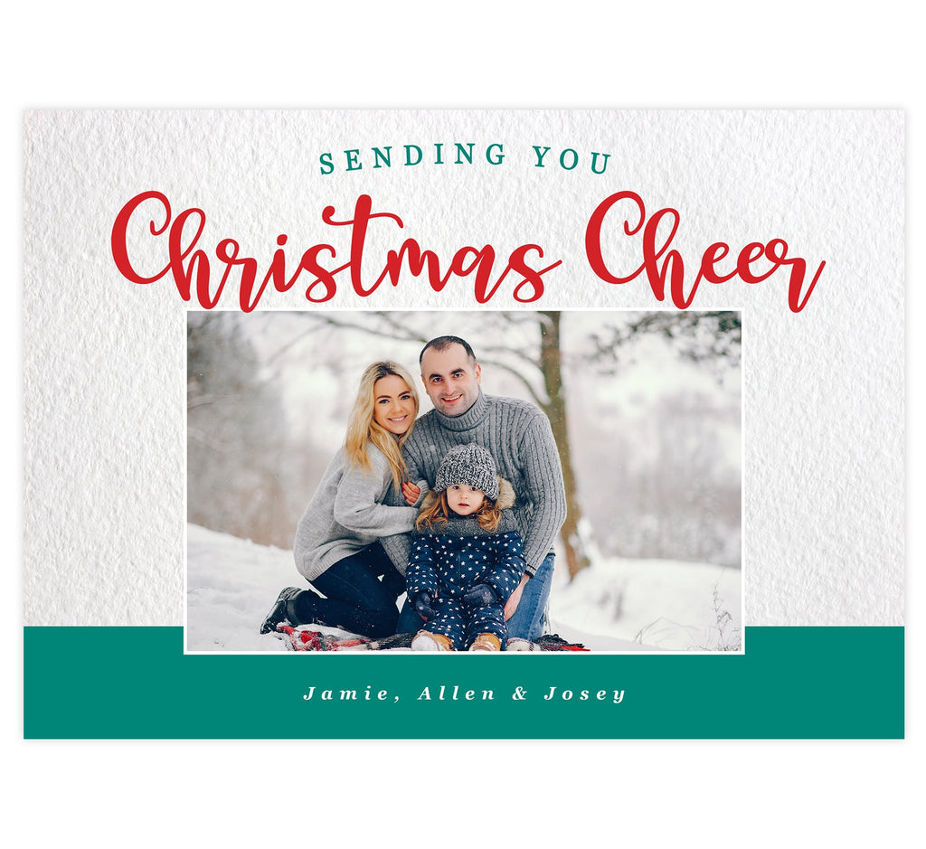 Christmas Cheer Holiday Card; Textured white background with teal and red text at the top and photo in the middle. Teal at the bottom with white text to include the family's names.