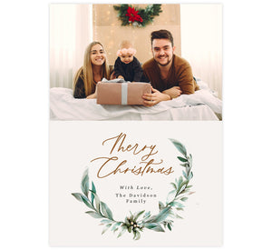 Christmas Wreath Holiday Card;  Features a watercolor wreath, subtle cream background, Christmas typography with a spot for a photo.