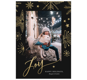 "Gold Joy Holiday Card; Dark black background with gold snowflakes and one image spot in the middle. Large, gold ""Joy"" is at the bottom overlapping the bottom of the image."