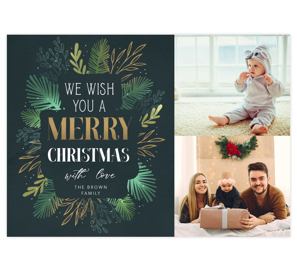 "Gold and Greenery Holiday Card; Dark green background with 2 stacked photos on the right side. Digitally drawn leaves on the left with ""We wish you a merry christmas"" overtop of the leaves."