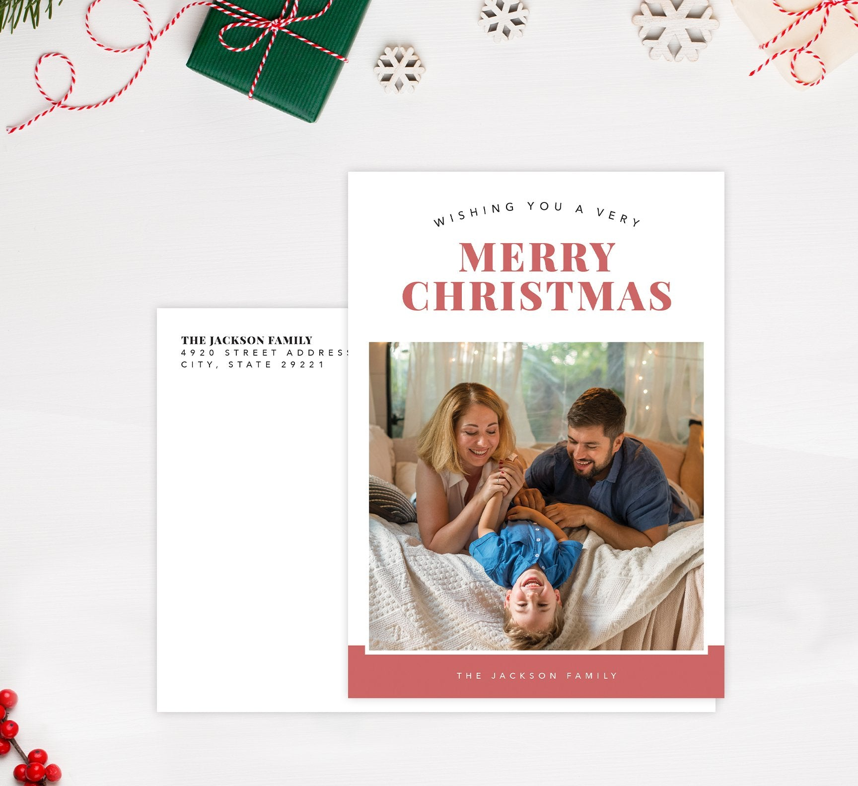 Happy Pink Holiday Card Mockup; Holiday card with envelope and return address printed on it.