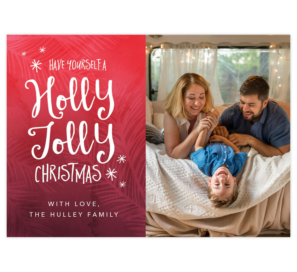 Holly Jolly Holiday Card; Red background with pink designs, hand written font to send Christmas wishes, and one large spot for your image.