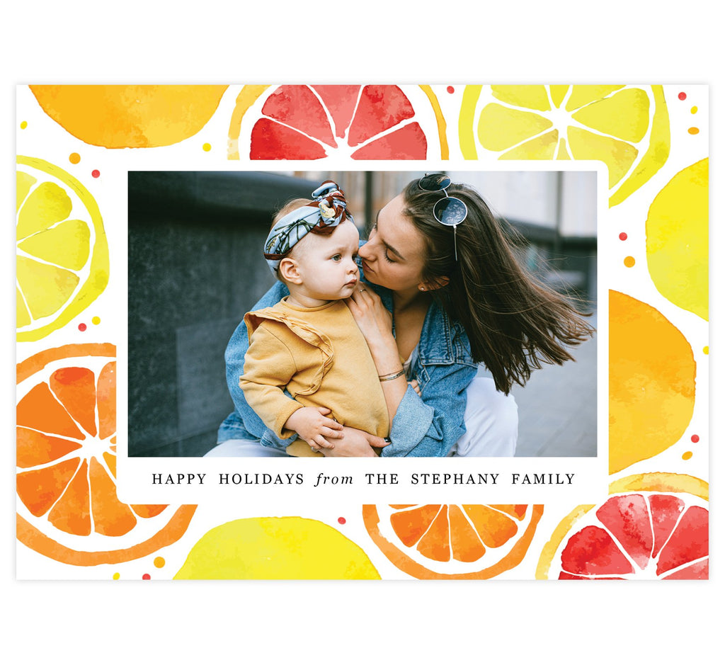 "Lemony Sweet Holiday Card; Colorful watercolor lemon slices background with one image spot in the middle and small ""Happy Holidays"" under the image."