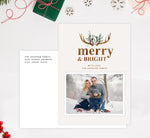 Load image into Gallery viewer, Merry Antlers Holiday Card Mockup; Holiday card with envelope and return address printed on it.