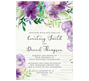 Elegant Purple Watercolor Wedding Invitation; white washed wood with black text and purple watercolor flowers on the top edge and bottom left corner.