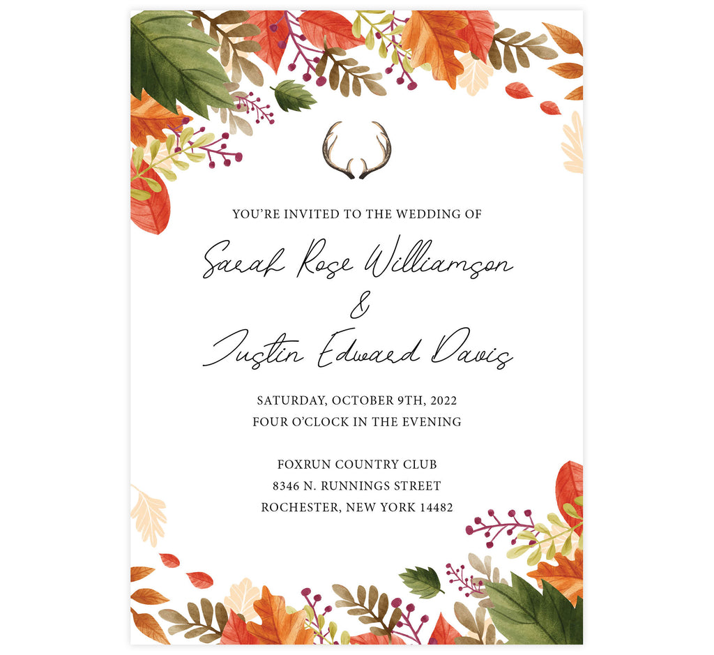 Rustic Fall wedding invitation; white background with black text. Fall leaves frame around the invite with deer antlers above the text.