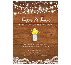 Rustic Glow wedding invitation; woodgrain background with string lights at the top, lace at the bottom edge. White text and yellow flowers