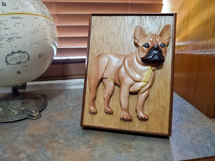 A Hand Carved Pet Urn featuring the Portrait of a French Bulldog