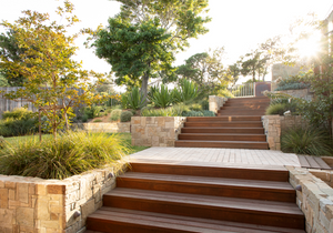 garden design with hardwood steps, retaining walls and buffalo lawn