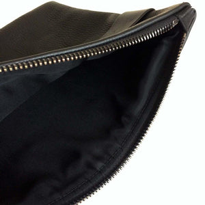Oversized foldover clutch with strap in pebble black
